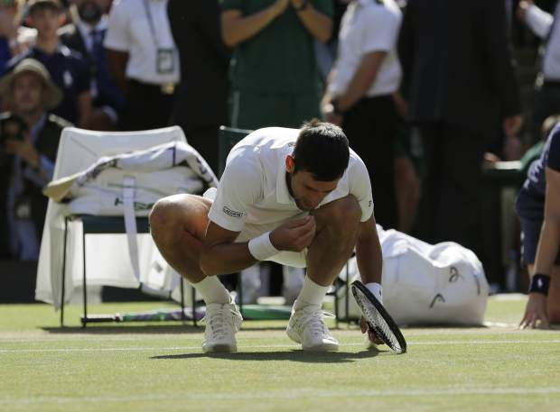 Novak Djokovic of Serbia celebrates defeating Kevin Anderson of South Africa in the men's singles final match at the Wimbledon Tennis Championships in London, Sunday July 15, 2018. (AP Photo/Ben Curtis)