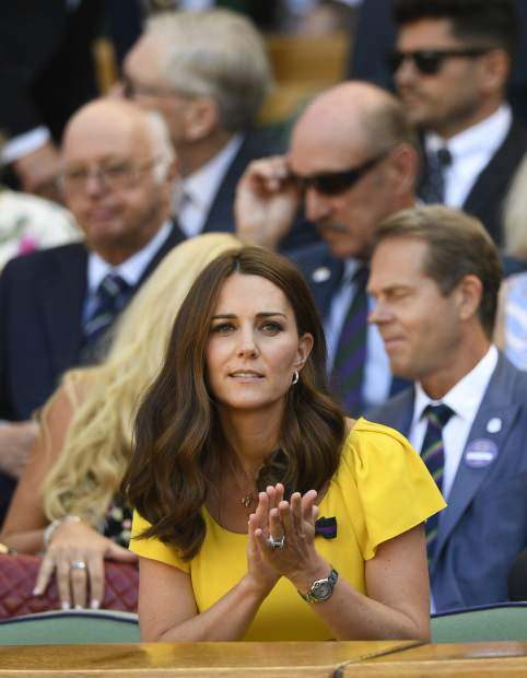 Britain's Kate, Duchess of Cambridge sits in the Royal Box on Centre Court during the men's singles final match between Novak Djokovic of Serbia and Kevin Anderson of South Africa at the Wimbledon Tennis Championships in London, Sunday July 15, 2018. (Neil Hall/Pool via AP)
