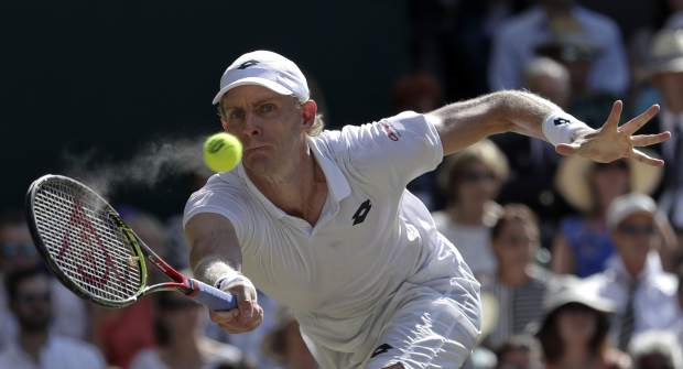 South Africa's Kevin Anderson returns the ball to Serbia's Novak Djokovic during the men's singles final match at the Wimbledon Tennis Championships in London, Sunday July 15, 2018. (AP Photo/Ben Curtis)