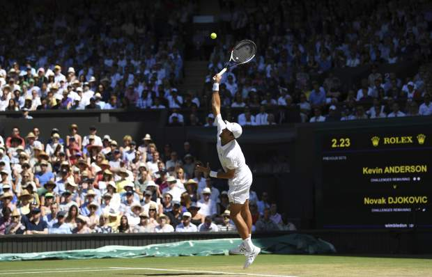 Novak Djokovic of Serbia serves to Kevin Anderson of South Africa during the men's singles final match at the Wimbledon Tennis Championships in London, Sunday July 15, 2018. (Neil Hall/Pool via AP)