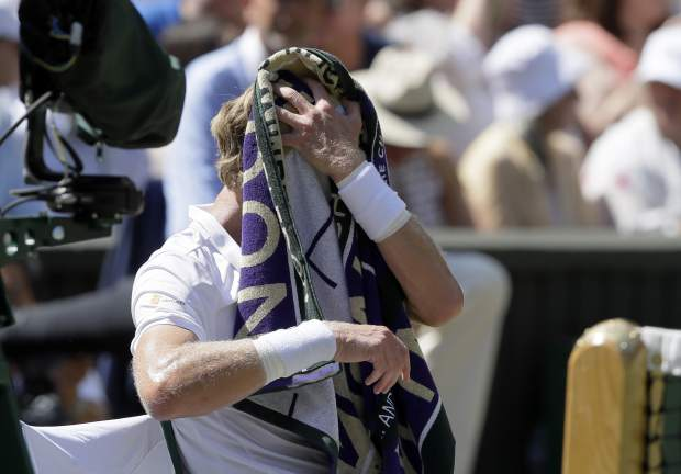 Kevin Anderson of South Africa wipes his head with a towel during the men's singles final match against Novak Djokovic of Serbia, at the Wimbledon Tennis Championships, in London, Sunday July 15, 2018.(AP Photo/Kirsty Wigglesworth)