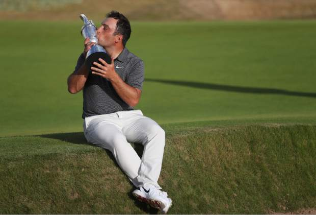 Francesco Molinari of Italy kisses the trophy after winning the British Open Golf Championship in Carnoustie, Scotland, Sunday July 22, 2018. (AP Photo/Peter Morrison)