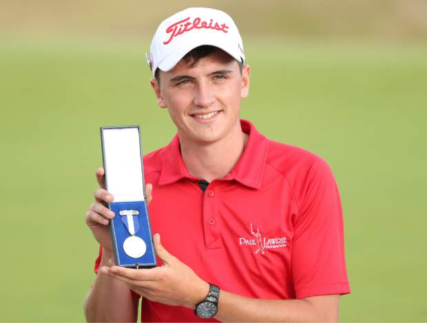 Sam Locke of Scotland poses for the media with the silver medal after winning top amateur in the British Open Golf Championship in Carnoustie, Scotland, Sunday July 22, 2018. (AP Photo/Peter Morrison)