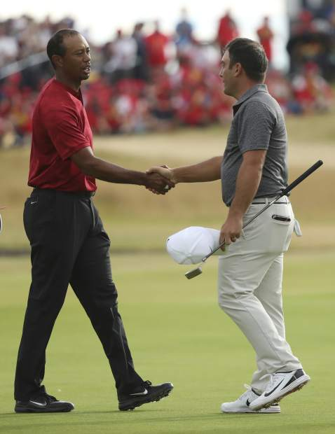 Francesco Molinari of Italy, right, and Tiger Woods of the US shake hands on the 18th hole after the final round for the 147th British Open Golf championships in Carnoustie, Scotland, Sunday, July 22, 2018. (AP Photo/Peter Morrison)