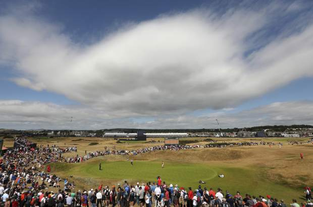 Bernhard Langer of Germany and Pat Perez of the US, left, on the 1st greenduring the final round of the British Open Golf Championship in Carnoustie, Scotland, Sunday July 22, 2018. (AP Photo/Jon Super)