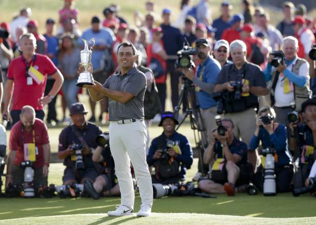 Francesco Molinari of Italy holds the trophy after winning the British Open Golf Championship in Carnoustie, Scotland, Sunday July 22, 2018. (AP Photo/Martin Cleaver)