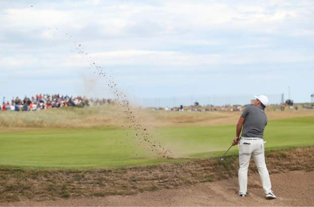 Francesco Molinari of Italy plays out of a bunker on the 6th green during the final round for the 147th British Open Golf championships in Carnoustie, Scotland, Sunday, July 22, 2018. (AP PhotoPeter Morrison)
