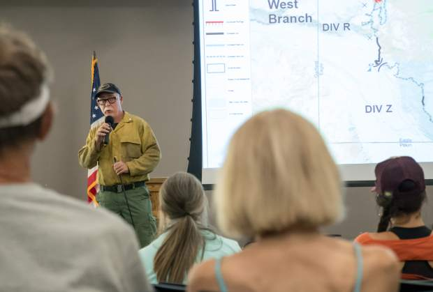 Roger Staats, Northern Rockies incident commander speaks to members of the public at the Lake Christine Fire community meeting held at Basalt High School on Monday evening.