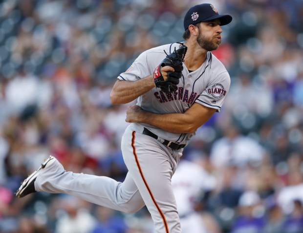 San Francisco Giants starting pitcher Madison Bumgarner delivers a pitch to Colorado Rockies' DJ LeMahieu in the first inning of a baseball game Monday, July 2, 2018, in Denver. (AP Photo/David Zalubowski)