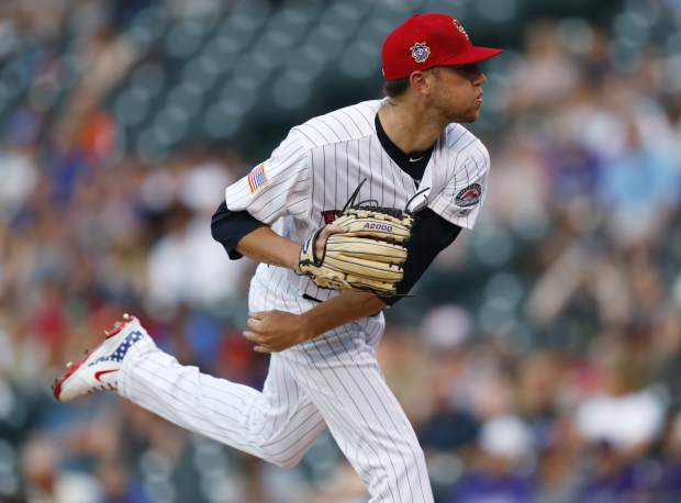 Colorado Rockies starting pitcher Kyle Freeland delivers a pitch to San Francisco Giants' Gorkys Hernandez in the first inning of a baseball game Monday, July 2, 2018, in Denver. (AP Photo/David Zalubowski)