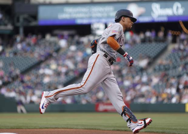 San Francisco Giants' Gorkys Hernandez circles the bases after hitting a solo home run off Colorado Rockies starting pitcher Kyle Freeland to lead off the first inning of a baseball game Monday, July 2, 2018, in Denver. (AP Photo/David Zalubowski)