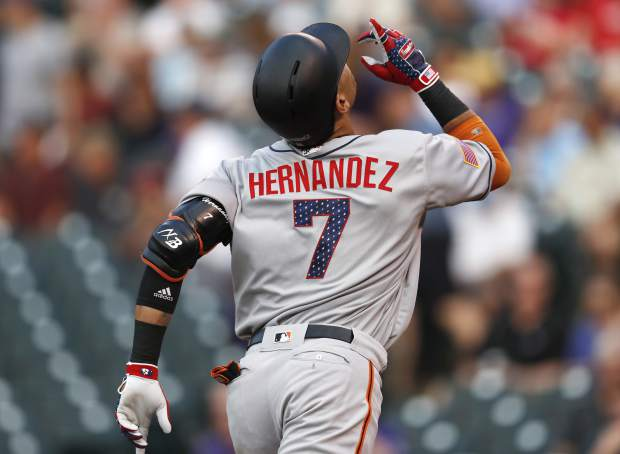 San Francisco Giants' Gorkys Hernandez gestures as he crosses home plate after hitting the first pitch thrown by Colorado Rockies starting pitcher Kyle Freeland for a solo home run in the first inning of a baseball game Monday, July 2, 2018, in Denver. (AP Photo/David Zalubowski)