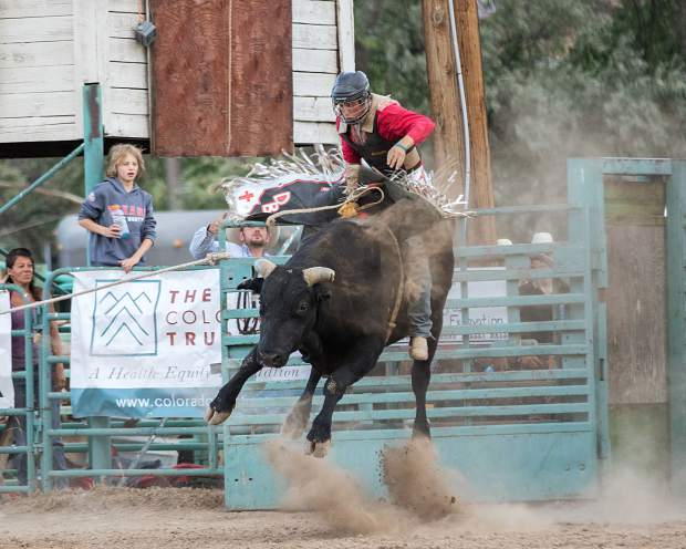 An unidentified rider in the Grand Valley Days Rodeo bull riding competition Saturday night.