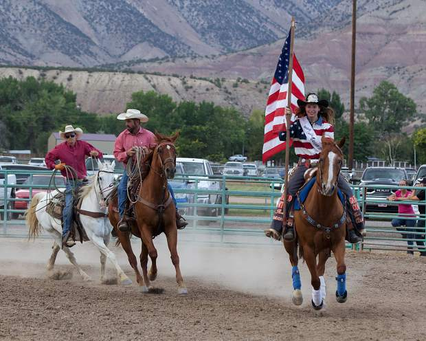 Garfield County Fair Queen Lexi Klein leads the participants into the arena for the Grand Valley Days Rodeo on Saturday night in Parachute. The festival included a parade, music, games and other activities, and concluded with a golf tournament on Sunday.