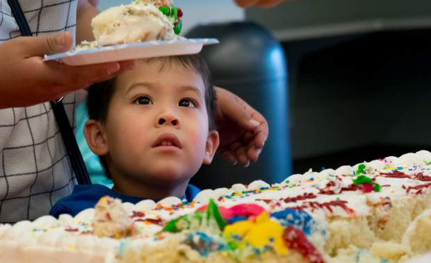 A young boy eagerly waits for his piece of cake at the party celebrating the 80th anniversary of the Garfield County Libraries at the Glenwood Springs branch on Tuesday afternoon. The party continues on Thursday, July 5, at 11:30 a.m. in Rifle and 2:30 p.m. in Parachute. Anyone and everyone is welcome to attend, and all events are free and open to the public as part of the Summer Reading Program.