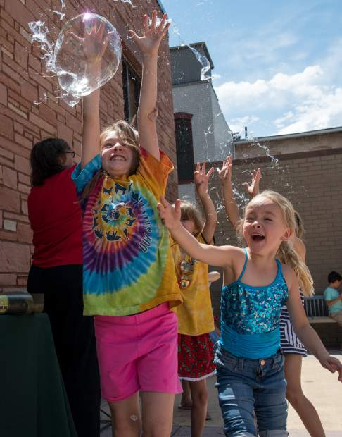 Kids enjoy playing with giant bubbles at the party celebrating the 80th anniversary of the Garfield County Libraries at the Glenwood Springs branch on Tuesday afternoon. The party continues on Thursday, July 5, at 11:30 a.m. in Rifle and 2:30 p.m. in Parachute. Anyone and everyone is welcome to attend, and all events are free and open to the public as part of the Summer Reading Program.
