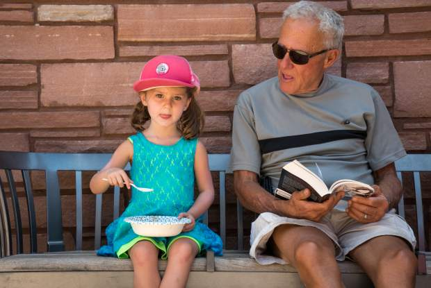 Three-year-old Pam Geiman eats cake and hangs out with her grandpa Les Seizer at the party celebrating the 80th anniversary of the Garfield County Libraries at the Glenwood Springs branch on Tuesday afternoon. The party continues on Thursday, July 5, at 11:30 a.m. in Rifle and 2:30 p.m. in Parachute. Anyone and everyone is welcome to attend, and all events are free and open to the public as part of the Summer Reading Program.