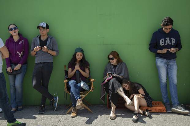 Voters wait in line outside a polling station during general elections in Mexico City, Sunday, July 1, 2018. Sunday's elections for posts at every level of government are Mexico's largest ever and have become a referendum on corruption, graft and other tricks used to divert taxpayer money to officials' pockets and empty those of the country's poor. (AP Photo/Anthony Vazquez)