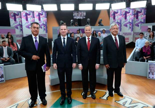 FILE - In this May 20, 2018 file photo released by the National Electoral Institute, INE, presidential candidates, from left, independent Jaime Rodriguez, known as