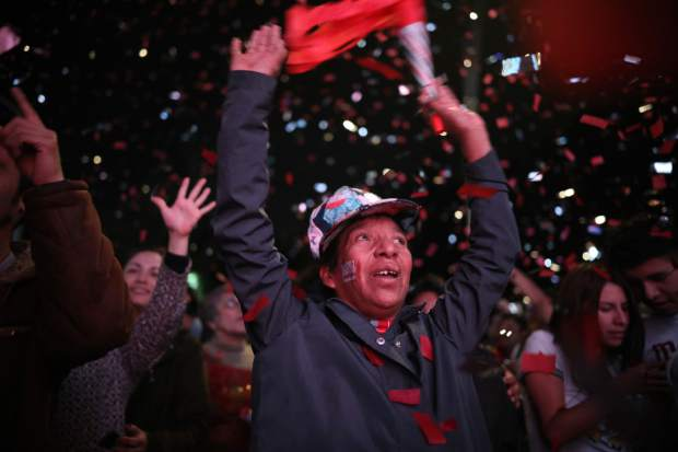 Supporters of presidential candidate Andres Manuel Lopez Obrador celebrate his victory in Mexico City's Alameda Central Park, Sunday, July 1, 2018. Lopez Obrador has claimed victory in Mexico's presidential election, calling for reconciliation after what he called a