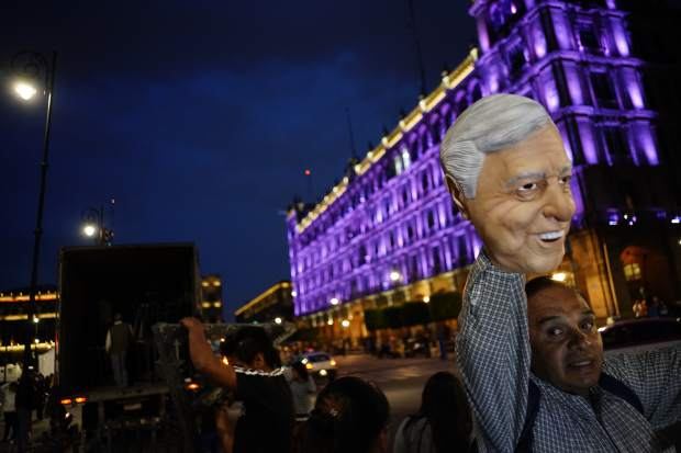 A street vendor sell a Andres Manuel Lopez Obrador mask in Mexico City's main square, the Zocalo, Sunday, July 1, 2018. Lopez Obrador is on the cusp of winning the presidency after the second of his two main rivals conceded defeat ahead of official results. (AP Photo/Ramon Espinosa)