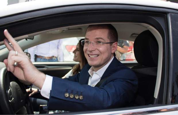 Presidential candidate Ricardo Anaya, of the PAN party, flashes a victory sign as he drives away from a polling station after voting in general elections in Queretaro, Mexico, Sunday, July 1, 2018. Sunday's elections for posts at every level of government are Mexico's largest ever and have become a referendum on corruption, graft and other tricks used to divert taxpayer money to officials' pockets and empty those of the country's poor. (AP Photo/Christian Palma)