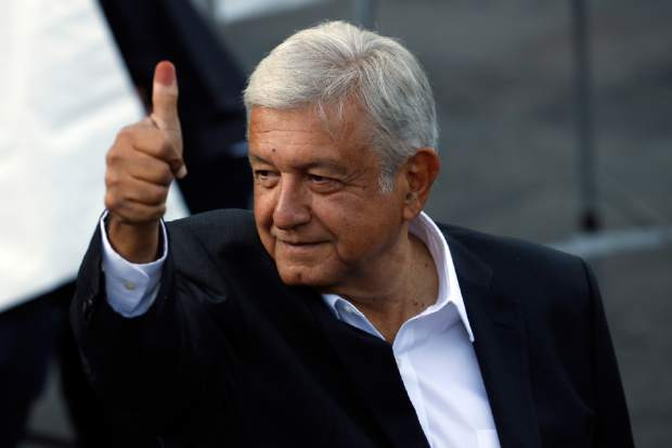 Presidential candidate Andres Manuel Lopez Obrador, of the MORENA party, during general election in Mexico City, Mexico, Sunday, July 1, 2018. Mexicans were voting Sunday in a potentially transformative election that could put in power a firebrand vowing to end politics and business as usual in a country weary of spiraling violence and scandal-plagued politicians. (AP Photo/Marco Ugarte)