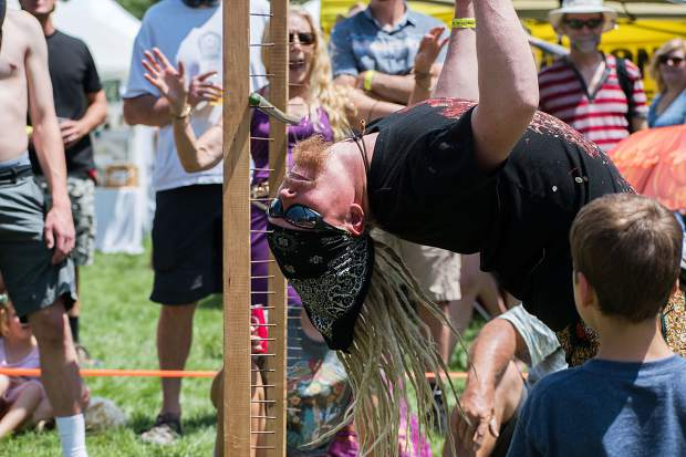 Zach Frederick stretches back as far as possible during the limbo contest at the 47th annual Carbondale Mountain Fair on Saturday afternoon.