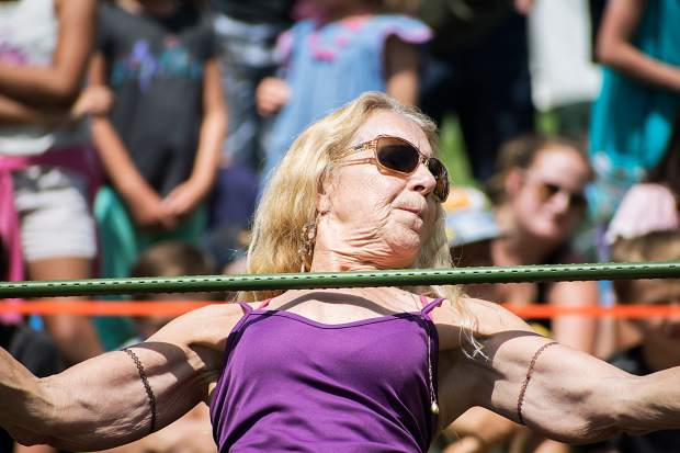 Sophia Jackson holds her breath and concentrates while participating in the limbo contest at the 47th annual Carbondale Mountain Fair on Saturday afternoon.