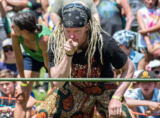 Zach Frederick focuses and points to the bar during an intense limbo contest at the 47th annual Carbondale Mountain Fair on Saturday afternoon.