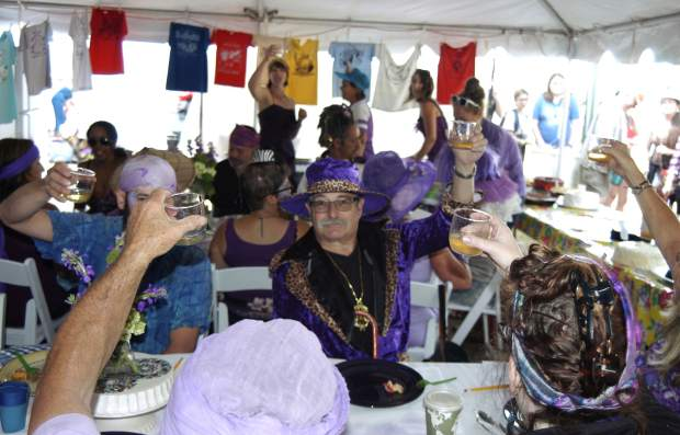 Mountain Fair cake contest judges, including Carbondale Trustee Marty Silverstein, lift a glass Sunday morning in memory of the late former cake judge Maureen