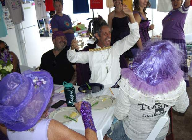 Cake contest judge Carlos Herrea reacts to a bribe offered from outside the judging tent during the traditional Sunday morning event at the 47th Annual Carbondale Mountain Fair. Purple was the theme color for the day (sported in the foreground with Carolyn Fisher's hat and Jennifer Lauckhart's wig; all in honor of longtime cake judge Maureen Nuckols, who died earlier this year.