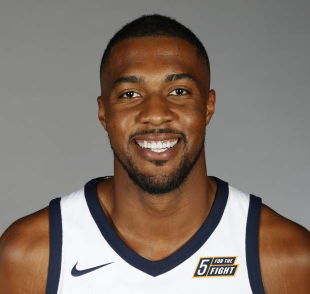 FILE - In this Sept. 25, 2017, file photo, Utah Jazz's Derrick Favors poses for a picture during team's media day, in Salt Lake City. Favors and the Jazz have come to terms on a two-year contract that could be worth up to $36 million, a person with knowledge of the negotiations told The Associated Press on Monday, July 2, 2018. (AP Photo/George Frey, File)