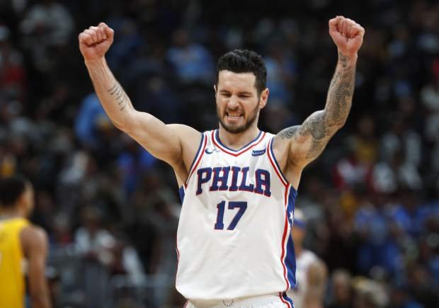 FILE - In this Dec. 30, 2017, file photo, Philadelphia 76ers guard JJ Redick celebrates in the final moments of a 107-102 win against the Denver Nuggets, in Denver.Redick is returning to the 76ers. A person familiar with the decision says the Sixers and Redick have agreed to a one-year contract. The person spoke to The Associated Press Monday, July 2, 2018, on condition of anonymity because the deal was not been announced. (AP Photo/David Zalubowski, File)