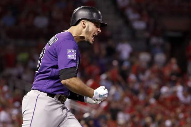 Colorado Rockies' Nolan Arenado celebrates after hitting a grand slam during the fifth inning of a baseball game against the St. Louis Cardinals Monday, July 30, 2018, in St. Louis. (AP Photo/Jeff Roberson)