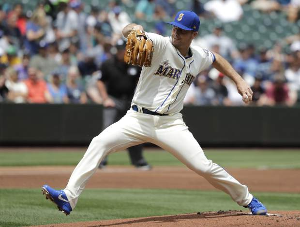 Seattle Mariners starting pitcher Wade LeBlanc throws against the Colorado Rockies during the first inning of a baseball game, Sunday, July 8, 2018, in Seattle. (AP Photo/Ted S. Warren)