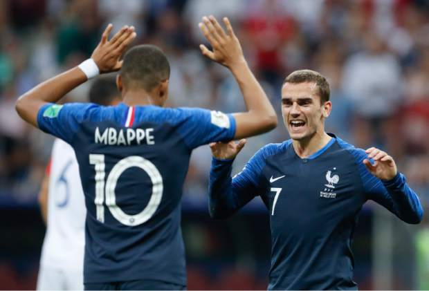 France's Antoine Griezmann celebrates with his teammate Kylian Mbappe, left, after Paul Pogba scored his side's 3rd goal, during the final match between France and Croatia at the 2018 soccer World Cup in the Luzhniki Stadium in Moscow, Russia, Sunday, July 15, 2018. (AP Photo/Petr David Josek)