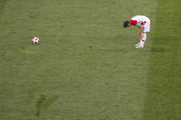 Croatia's Luka Modric prepares to kick the ball during the final match between France and Croatia at the 2018 soccer World Cup in the Luzhniki Stadium in Moscow, Russia, Sunday, July 15, 2018. (AP Photo/Rebecca Blackwell)