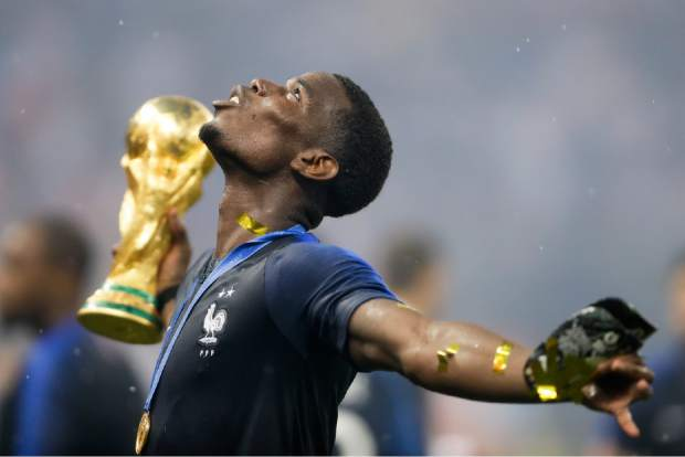 France's Paul Pogba celebrates with the trophy after the final match between France and Croatia at the 2018 soccer World Cup in the Luzhniki Stadium in Moscow, Russia, Sunday, July 15, 2018. (AP Photo/Natacha Pisarenko)