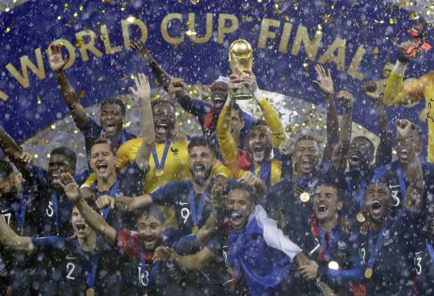 France goalkeeper Hugo Lloris holds the trophy aloft after the final match between France and Croatia at the 2018 soccer World Cup in the Luzhniki Stadium in Moscow, Russia, Sunday, July 15, 2018. France won the final 4-2. (AP Photo/Matthias Schrader)