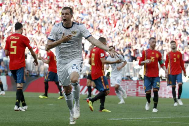 Russia's Artyom Dzyuba celebrates scoring his side's opening goal during the round of 16 match between Spain and Russia at the 2018 soccer World Cup at the Luzhniki Stadium in Moscow, Russia, Sunday, July 1, 2018. (AP Photo/Antonio Calanni)