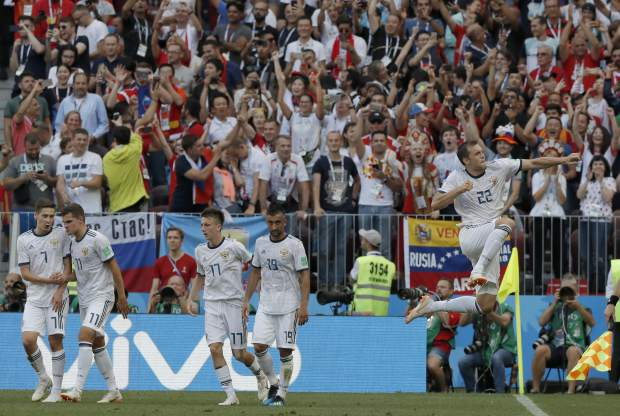 Russia's Artyom Dzyuba celebrates after scoring his sides 1st goal from the penalty spot during the round of 16 match between Spain and Russia at the 2018 soccer World Cup at the Luzhniki Stadium in Moscow, Russia, Sunday, July 1, 2018. (AP Photo/Manu Fernandez)