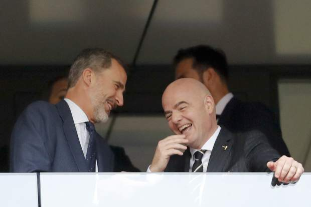 Spain's King Felipe, left, and FIFA President Gianni Infantino share a laugh during the round of 16 match between Spain and Russia at the 2018 soccer World Cup at the Luzhniki Stadium in Moscow, Russia, Sunday, July 1, 2018. (AP Photo/Antonio Calanni)