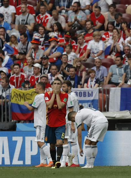 Spain's Koke, centre reacts after missing a cahnce on goal during the round of 16 match between Spain and Russia at the 2018 soccer World Cup at the Luzhniki Stadium in Moscow, Russia, Sunday, July 1, 2018. (AP Photo/Manu Fernandez)