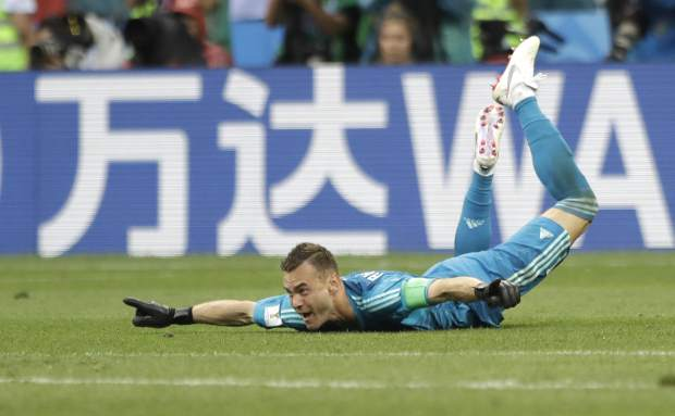 Russia goalkeeper Igor Akinfeev celebrates after his team advanced to the quarterfinal during the round of 16 match between Spain and Russia at the 2018 soccer World Cup at the Luzhniki Stadium in Moscow, Russia, Sunday, July 1, 2018. (AP Photo/Matthias Schrader)