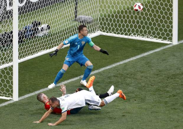 Russia's Sergei Ignashevich, front, scores an own goal during the round of 16 match between Spain and Russia at the 2018 soccer World Cup at the Luzhniki Stadium in Moscow, Russia, Sunday, July 1, 2018. (AP Photo/Vincent Michel)