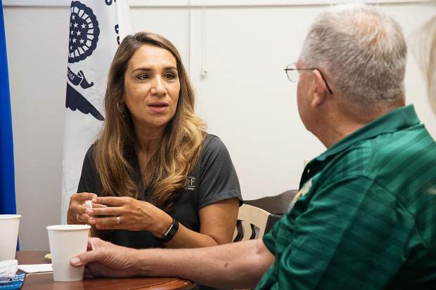 Luz Lovins, left, director of development for the Vietnam Veterans Memorial Fund in Washington, D.C, pays a visit to the Glenwood Springs Veterans Resource Center on Thursday morning. She spent time speaking with John Pettit and other veterans at the center before visiting Aspen.