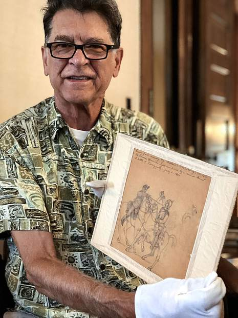 Bill Kight, executive director of the Glenwood Springs Historical Society, holds a drawing by Theodore Von Rosenberg that was donated by his great-great-great-grandson. The drawing was from memory by Von Rosenberg, who served in the Austrian Army. The drawing depicts Rosenberg, on the left, thrusting a sword into a Prussian officer during the battle of Koniggratz on July 3, 1866.
