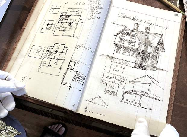 Bill Kight, executive director of the Glenwood Springs Historical Society, flips through the personal sketch book of Theodore Von Rosenberg. The book holds page after page of pen and ink drawings of the architect who is responsible for many prominent buildings in Glenwood Springs.