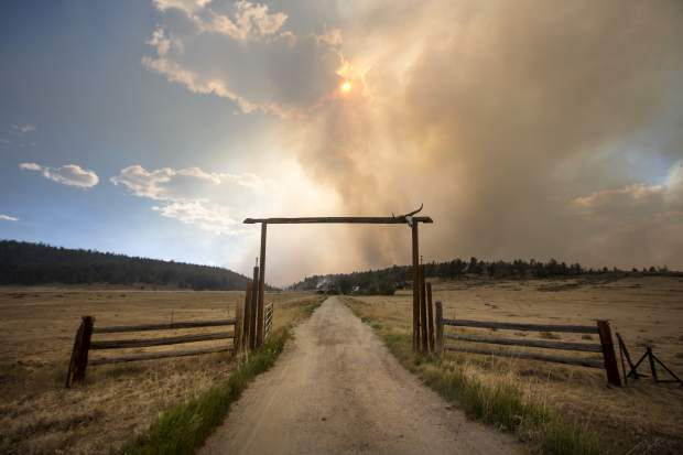 The Weston Pass Fire threatens homes along Highway 285, Monday, July 2, 2018, near Fairplay, Colo. In Colorado, more than 2,500 homes were under evacuation orders as firefighters battled more than a half-dozen wildfires. (Hugh Carey/Summit Daily News via AP)